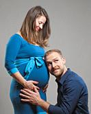 Pregnant Woman with her Man listening to the Belly.