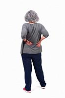 full portrait of the back of an older woman with pain in the back on white background.