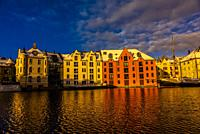 Beautiful former warehouses along the canal in the Brosundet quarter in Art Nouveau (Jugendstil) architectural style, Alesund, Norway. Most of the tow...