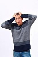 man with expression of forgetfulness or surprise on white background.