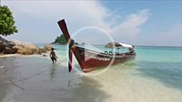 Longtail boat swining on waves near Serendipity beach on Ko Lipe island, Thailand