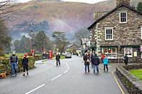 Hikers and walkers in Grasmere village in the Lake District national park on a winters day,Cumbria,England.