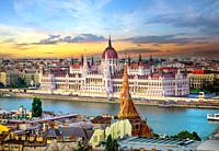 Bright sunset over famous landmarks in Budapest.