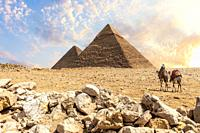The Great Pyramids in the desert of Giza with the bedouins nearby, Cairo, Egypt.