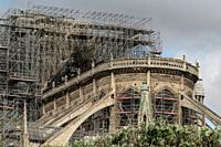 PARIS, FRANCE - 19 APRIL 2019 Notre Dame cathedral, after the timber roof caught fire. The melted scaffolding, constructed for the exact purpose of re...