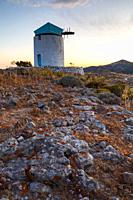 Old windmill near Chora village on Kimolos island in Greece. .