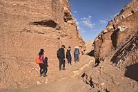Trekking through the desert landscape in the Moon Valley, San Pedro de Atacama, Chile.