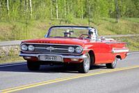 Salo, Finland. May 18, 2019. Classic 1960s red Chevrolet Impala Convertible on the road on Salon Maisema Cruising 2019. Credit: Taina Sohlman/agefotos...