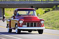 Salo, Finland. May 18, 2019. Woman drives a mid-1950s Chevy pickup, the man on passengers seat is photographing on Salon Maisema Cruising 2019. Credit...