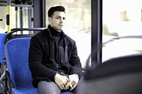 young man sitting in bus, in Munich, Germany.