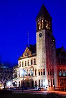 The Albany, NY City Hal is illuminated at dusk.