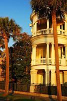 A curved, three stored veranda graces a historic home in Charleston, South Carolina.