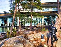 Sculpted figure leaning against tree, Artipelag, Halludden Peninsula, Varmdo, Sweden, Scandinavia. Artipelag is an international venue for art, cultur...