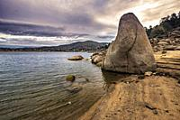 Granite rocks by Burguillo reservoir at sunrise. Avila. Spain. Europe.