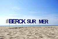Sign with big letters on sandy beach at seaside resort Berck / Berck-sur-Mer along the North Sea coast, Côte d'Opale / Opal Coast, France