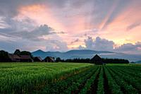 Clearing storm over a rural landscape with traditional barns in Turiec region, central Slovakia.