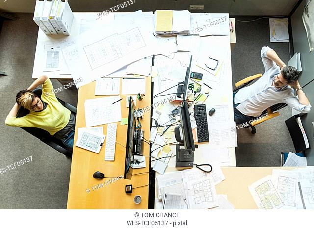 Male and female architects working in office, view from above