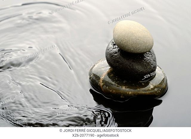 Three Spa stones on water
