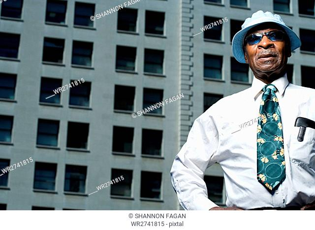 Senior man outside a building