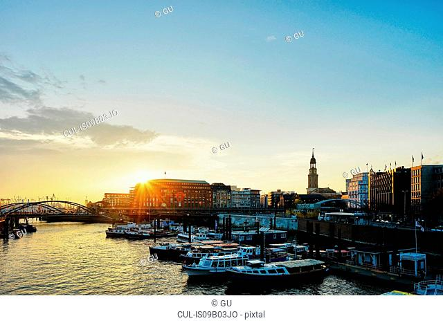 River boats on waterfront at sunset, Hafencity, Hamburg, Germany