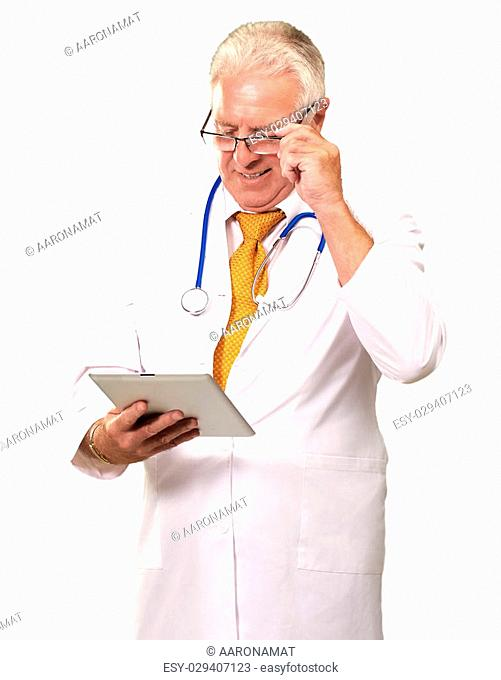 Portrait Of A Male Doctor Holding A Tab On White Background