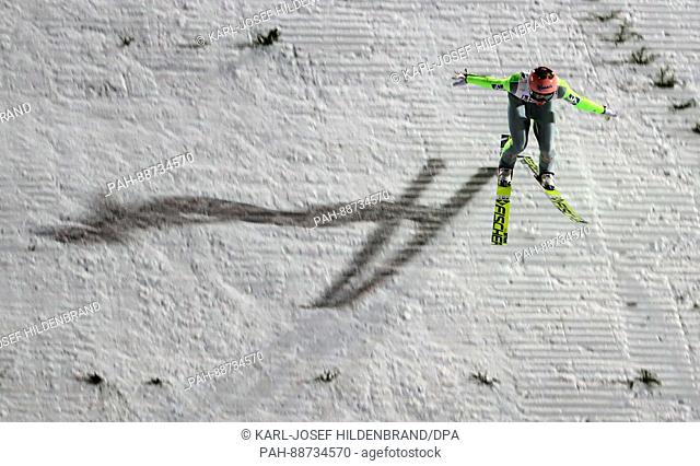 Stefan Kraft from Austria competes in the men's large hill ski jumping team event at the Nordic Ski World Championship in Lahti, Finland