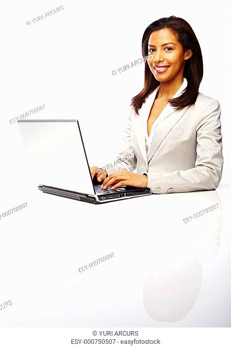 Beautiful African American business woman with laptop on white