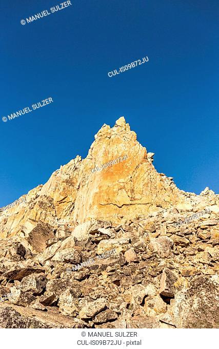 Mountain pinnacle and blue sky, Nahuel Huapi National Park, Rio Negro, Argentina