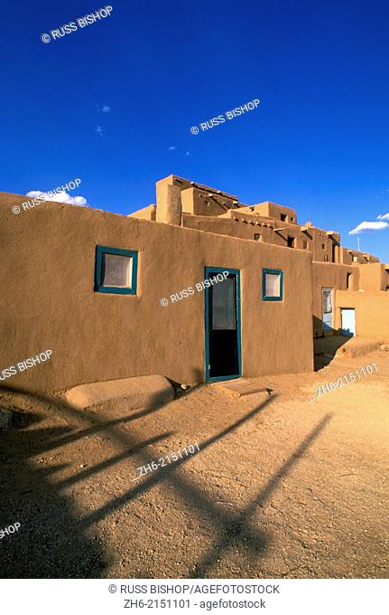 Evening light on the 3-story adobe North House (World Heritage Site), Taos Pueblo, New Mexico USA