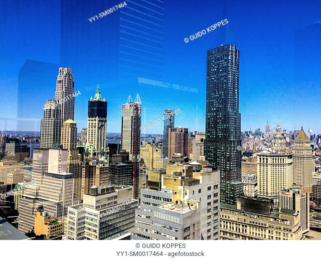New York City, USA. View on Manhattan's Skyline from a down town skyscraper rooftop