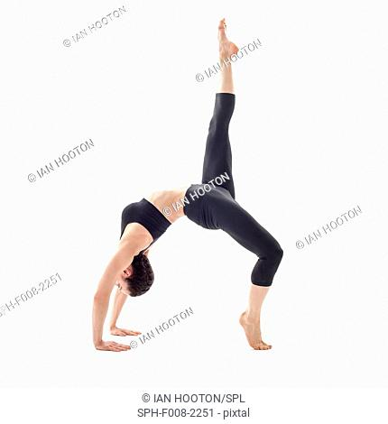 MODEL RELEASED. Woman practicing yoga. This is the bridge pose