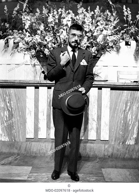 The TV contender Gianluigi Marianini wearing an elegant suit on the terrace of his home. The man distinguished himself in the TV show Leave or Double it? as an...