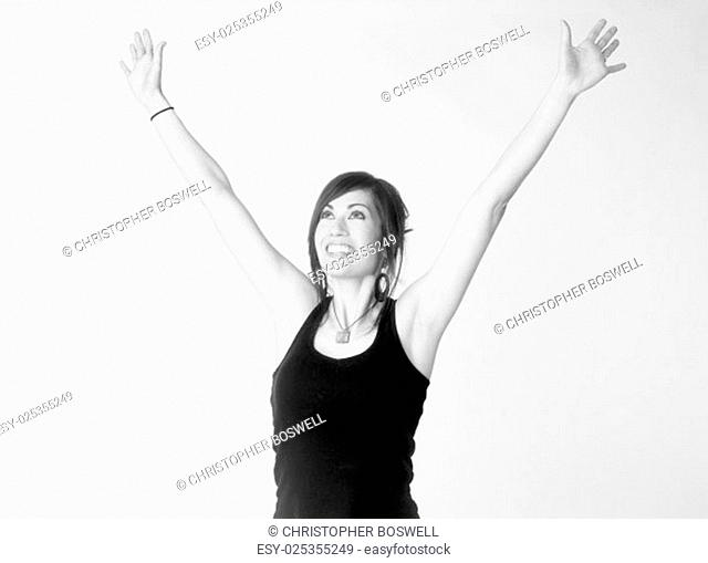 A monochrome representation of woman reaching up excited and happy