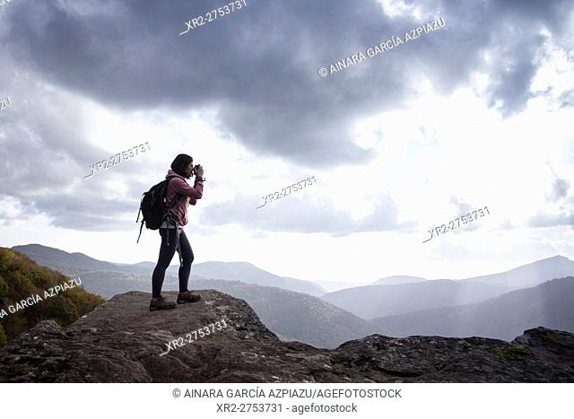 Woman backpacker in Zamariain viewer, Navarre, Spain