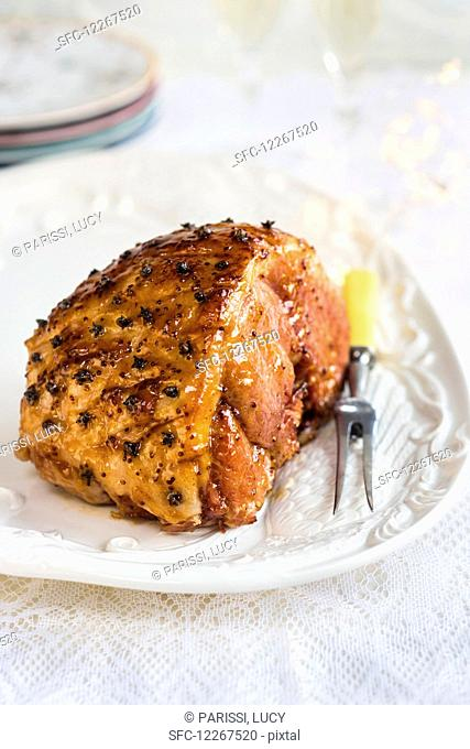 Glazed ham garnished with carnations