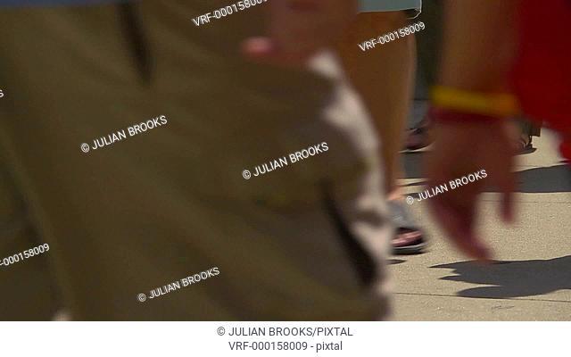 Chicago street scene, anonymous feet walking slow motion, backlit