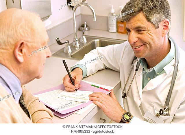 Doctor, reviewing and updating patient's, medical records
