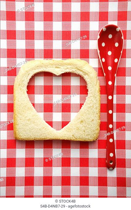 Heart silhouette cutted into a slice of toast