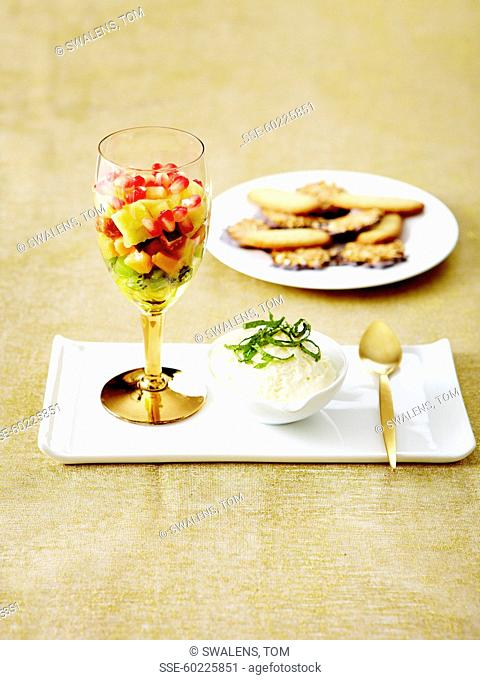 Lemon mousse,exotic fruit salad and crispy cookies