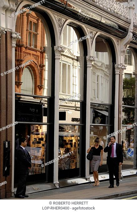 England, London, Bond Street, Reflections in the shop front of Asprey jewellers on New Bond Street