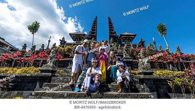 Devout Balinese posing with European tourists, split gate, Candi bentar, mother temple Besakih, Pura Agung Besakih Penetaran, Banjar Besakih, Bali, Indonesia