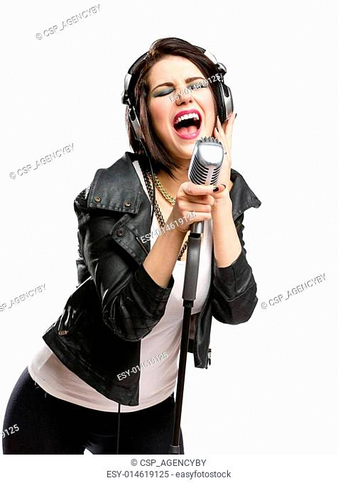 Rock singer with microphone and earphones