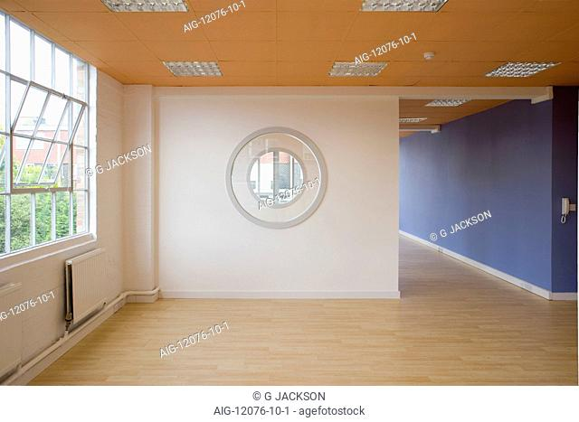Renovated small empty office units with wooden floors