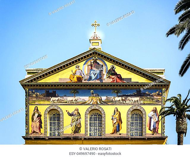 detail of the golden mosaic placed in the Tympanum of the Basilica of Saint Paul outside the walls in Rome