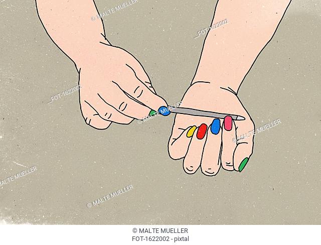 Close-up of woman filing her fingernails