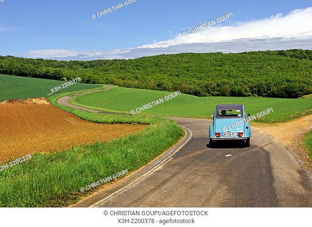 Citroen 2CV car on a country road near Sedan, Ardennes department, Champagne-Ardenne region of northeasthern France, Europe
