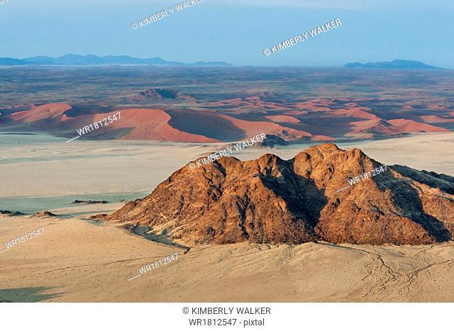 Aerial view of dunes while ballooning over Sossusvlei at sunrise, Namib Desert, Namibia, Africa