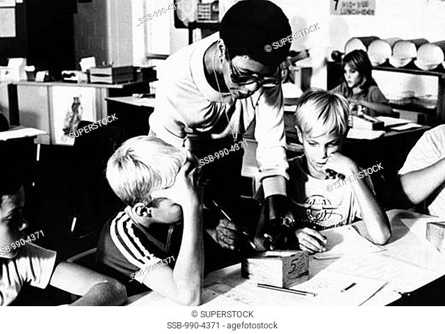 Female teacher teaching students in a classroom