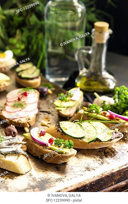 Bruschetta with various toppings on a rustic table