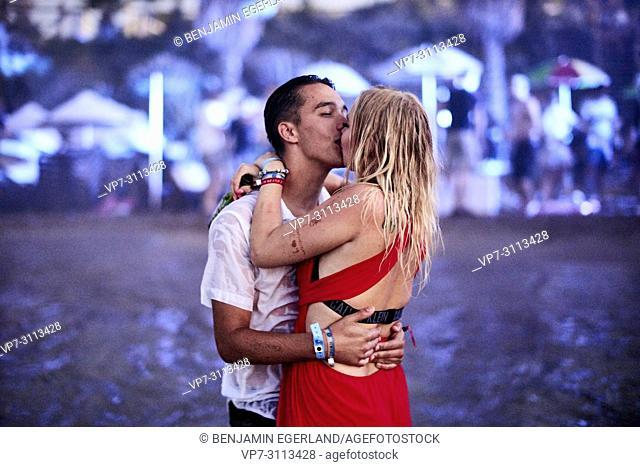 Greece, Crete, Chersonissos, passionate couple kissing at Beach Party